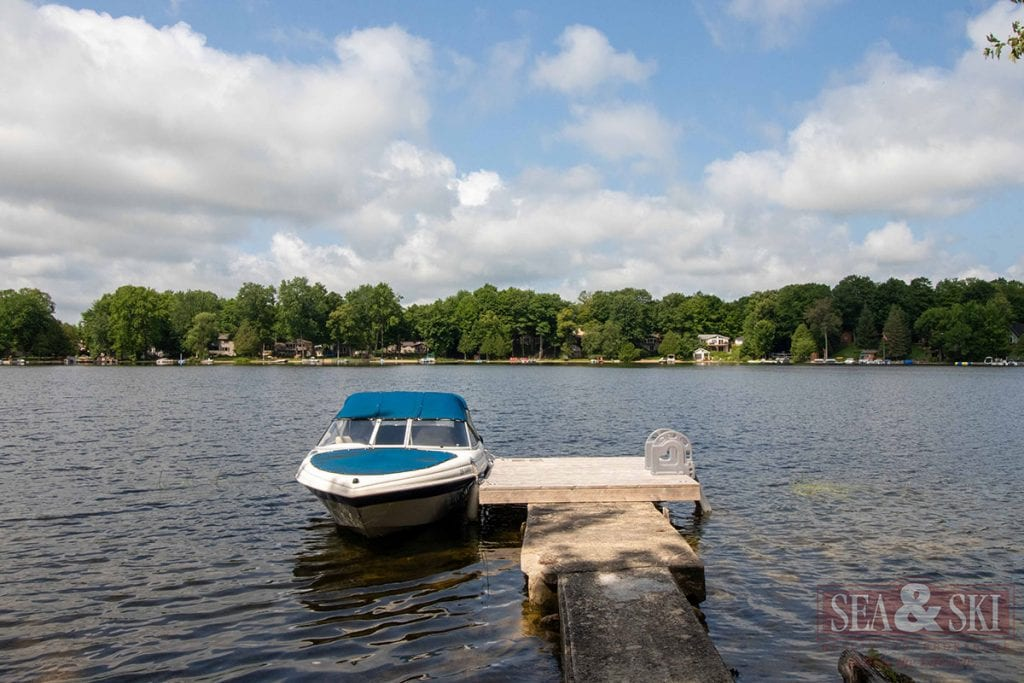 view of McCullough Lake with dock & boat